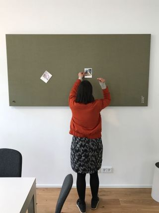 Jessica checks out our new noise absorbing pinboard in Hygge.eins